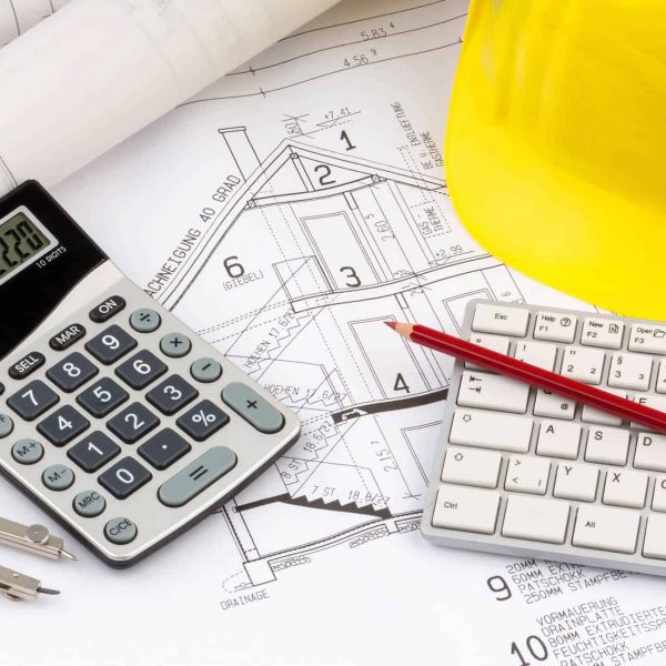 a blueprint of an architect with the hard hat of a construction worker. symbolic photo for financing and planning of a new house.